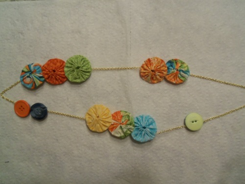 Here ia a necklace I made from fabric yo-yos and buttons.