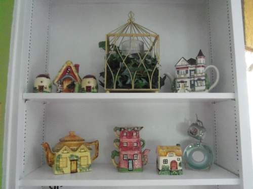 Here is some of my cottage ware. I began with one little house-shaped pitcher. I added a sugar, a creamer, then a salt and pepper shaker. My collection has grown so much now that I change them out  when I want a new display.