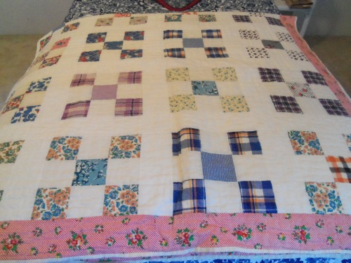 Here is the multicolored patchwork quilt that my grandmother and I made together. On the underside she embroidered our initials and the year it was finished, which was 1979.